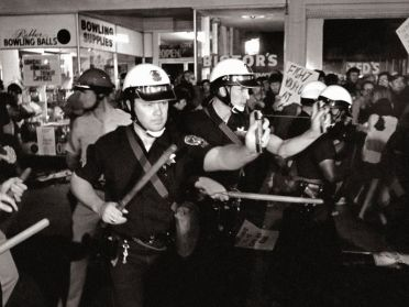 Police using Mace in a 60's riot